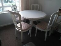 BARELY USED SOLID WOOD DINING TABLE AND CHAIRS FOX PATTERN