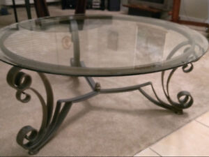 Must Go, Best Offer.  Round glass coffee table, iron base.