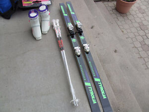 Ladies Tyrolia downhill skiis, poles, and boots size 7