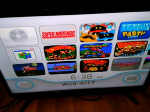 NINTENDO WII SYSTEM WITH REGTO GAMES AND MEMORY CARD