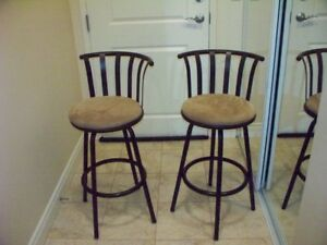 Two Bar stools , with leg extensions