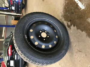 Winter tires on rim, only used one winter $400.00 OBO