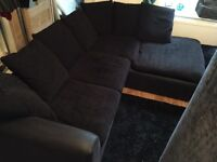 REDUCED black fabric corner sofa. Extremely comfortable.