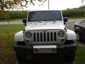 2014 Jeep Wrangler Unlimited - Sahara VUS