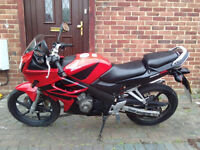 Red Honda CBR 127 for sale.