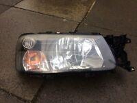 2003 Subaru Forester drivers headlight