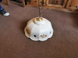 Ceramic shade with brass hanging chain.