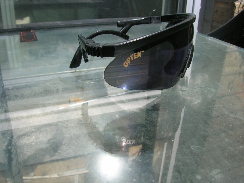 529dc31c6dc Description. Selling a rare new pair of Optek sport m frame shield style sunglasses  made in the USA ...