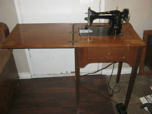 Woodsonia Antique sewing machine in wood cabinet - $20