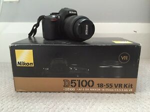 Nikon D5100 w/ 18-55mm lens kit (tag: canon, Sony, DSLR)
