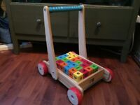 Wooden push along trolley with bricks (ELC)