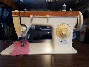Used singer sewing machine with cabinet