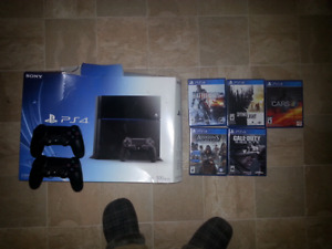 Playstation 4 with 2 CONTROLLERS and 5 games . GREAT DEAL !!!!