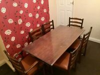 Dinning Table (wood colour ) with 6 chairs in Good condition