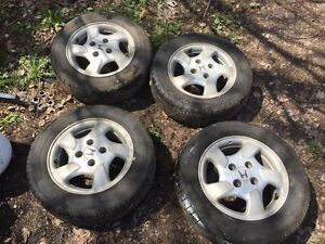Like Brand New 195/65/15 summer tires and rims for sale