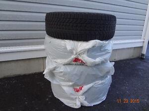 One set of four used winter tires for Honda Odyssey