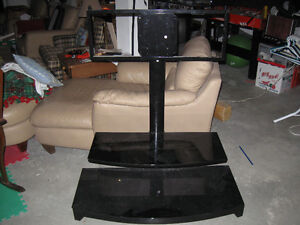 Black T.V. Stand with 2 black glass shelves
