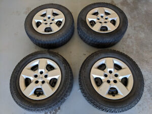 4 Arctic Claw Winter Tires Set on Steel Rims  - 215/70 R16