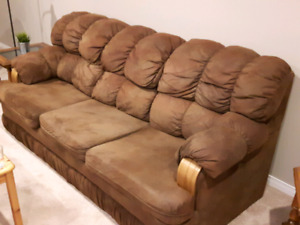 Brown cloth couch and chair