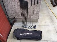 Full set of graphite irons golf clubs, Taylor made bag, driver, 3 wood & 5 wood.