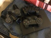 Ps2 slim with 35+ games 3 controllers and memory cards