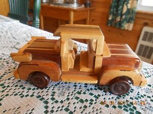UNIQUE MINATURE HAND MADE SOLID WOOD TRUCK.