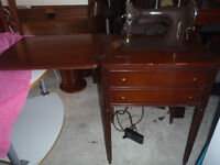 vintage white sewing machine and table still works great