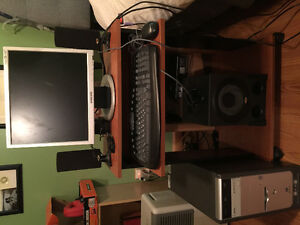 Computer, desk, monitor, speakers, keyboard and mouse