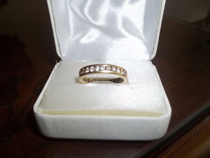 APPRAISED FOR $3,250.00 IS THIS BEAUTIFUL ETERNITY BAND(CASH)