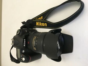 Nikon D90 plus Nikon AF-S 18-200 3.5 5.6 lens plus carry case