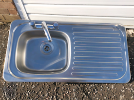 Kitchen sink with tap