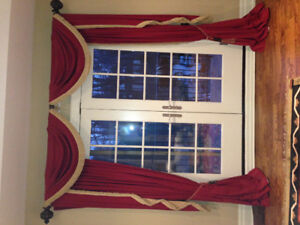 red curtains with matching wall sconces. 84x102 window