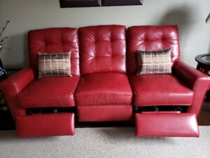 Red leather sofa, w/ motion.
