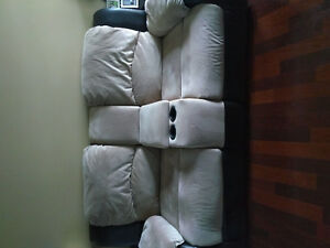 2 seat reclining love seat with throw pillows