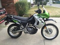 Looking to trade my silver klr650 side fairings for black ones