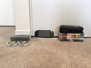 PSP with 4 games, 7 game cases and 2 cases