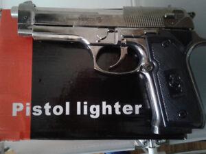 PISTOL LIGHTER for sale brand new in box.