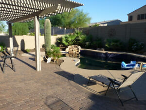 Oasis Style Backyard with Heated Pool in Goodyear Arizona