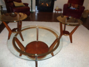 One round glass coffee table and two round end tables