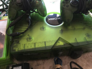 Xbox with two controllers and games