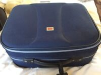 Small blue suitcase hand luggage