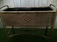 Vintage early 1900 wicker plant stand