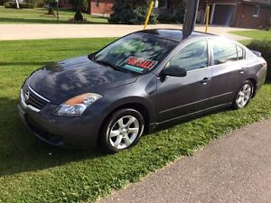 Clean Altima with winter tires London Ontario image 1