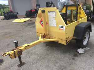 Axle with wheels and leaf springs on frame with plastic fenders,