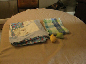 2 baby blankets and 2 pairs of socks