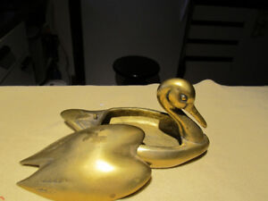 Vintage brass swan with removeable top cover.