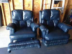 Two blue recliner couches
