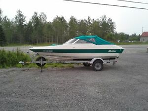 Cutter Jet boat with 175 HP Mercury motor with trailer