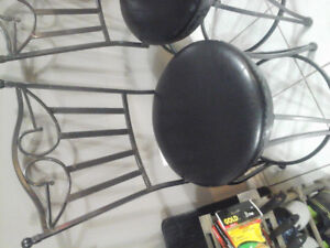 4 black steel swivel counter top chairs
