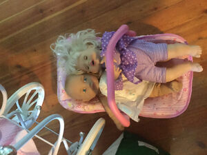 3 dolls with bag of clothes, chair and stroller